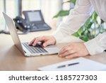 businessman using laptop... | Shutterstock . vector #1185727303