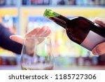 woman refusing more alcohol... | Shutterstock . vector #1185727306