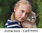 young girl with cat on natural... | Shutterstock . vector #118579594