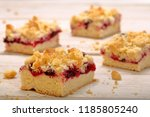 cake with fruit and crumble on... | Shutterstock . vector #1185805240