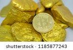 bitcoin coin on gold chunks | Shutterstock . vector #1185877243