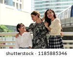 friends are walking around the...   Shutterstock . vector #1185885346