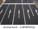five paved lanes with direction ... | Shutterstock . vector #1185890026