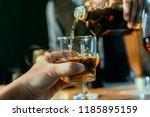 bartender hand  glass of... | Shutterstock . vector #1185895159