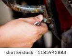 motorcycle mechanic hands... | Shutterstock . vector #1185942883
