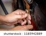 motorcycle mechanic hands... | Shutterstock . vector #1185942889