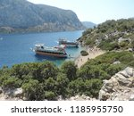 aegean island and ships    Shutterstock . vector #1185955750