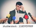 nervous man is sweating  he... | Shutterstock . vector #1185959989