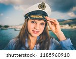 happy female captain with... | Shutterstock . vector #1185960910