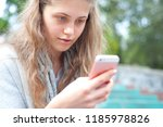 young pretty girl using a smart ... | Shutterstock . vector #1185978826