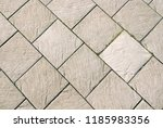 grey square tiles. paved... | Shutterstock . vector #1185983356