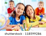 portrait of two diligent girls... | Shutterstock . vector #118599286