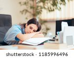 tired woman working extra hours ... | Shutterstock . vector #1185996496