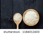 a grain of rice in a wooden cup ... | Shutterstock . vector #1186012603