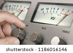 man turning volume button of a... | Shutterstock . vector #1186016146