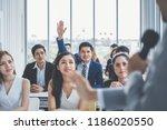 business man raising hand for... | Shutterstock . vector #1186020550