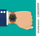 wristwatch on the hand of... | Shutterstock .eps vector #1186030909