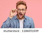 indignant young caucasian guy...   Shutterstock . vector #1186051039