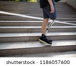 young man with prosthetic leg... | Shutterstock . vector #1186057600
