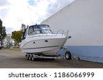 new motor boat still on the... | Shutterstock . vector #1186066999