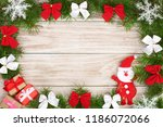 christmas frame made of fir... | Shutterstock . vector #1186072066
