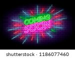 coming soon with rays neon sign.... | Shutterstock .eps vector #1186077460