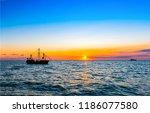 sunset sea ship silhouette... | Shutterstock . vector #1186077580