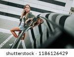 portrait of cheerful woman... | Shutterstock . vector #1186126429