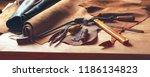 shoemaker's work desk. tools... | Shutterstock . vector #1186134823