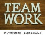 team work word made from wooden ... | Shutterstock . vector #1186136326