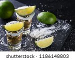 tequila with sliced and whole... | Shutterstock . vector #1186148803