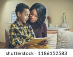 story tale time. african family. | Shutterstock . vector #1186152583