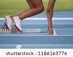 woman in a starting block on an ...   Shutterstock . vector #1186163776