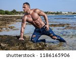 muscular young wet naked... | Shutterstock . vector #1186165906