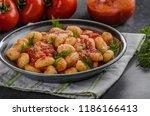 gnocchi tomato sauce herbs ...   Shutterstock . vector #1186166413