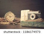 retro old camera with pile of... | Shutterstock . vector #1186174573