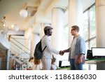 two intercultural college guys...   Shutterstock . vector #1186186030