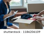 young couple packing and... | Shutterstock . vector #1186206109