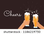 two hands holding beer glasses. ... | Shutterstock .eps vector #1186219750
