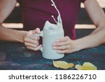 young woman holding stein  clay ... | Shutterstock . vector #1186226710
