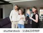 three person standing in living ... | Shutterstock . vector #1186235989
