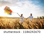 husband and wife walks with... | Shutterstock . vector #1186242670