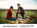 man makes a marriage proposal... | Shutterstock . vector #1186242799