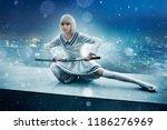 Anime Girl With Sword On Edge...