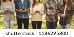 group of friends distracted... | Shutterstock . vector #1186295800