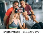 friends having fun at the gym.... | Shutterstock . vector #1186299199