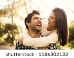 happy couple in the park... | Shutterstock . vector #1186302133