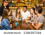 a group of friends making a... | Shutterstock . vector #1186307266
