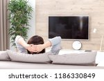 young woman watching tv in the... | Shutterstock . vector #1186330849