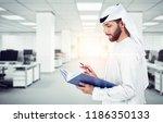 arab emirati man writing on a... | Shutterstock . vector #1186350133
